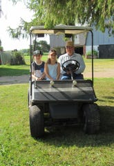 Eli, Arianna, (two of Rachel's children) and Grandpa Bob heading out for a drive on the farm.