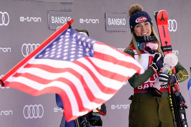 United States' Mikaela Shiffrin smiles on the podium after winning an alpine ski, women's World Cup super-G, in Bansko, Bulgaria.