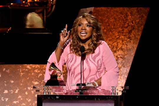"""Gloria Gaynor accepts the award for best roots gospel album for """"Testimony""""."""