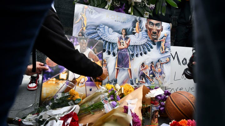 Jan 26, 2020; Los Angeles, CA, USA; Fans mourn the loss of NBA legend Kobe Bryant outside of the Staples Center in Los Angeles. Mandatory Credit: Harrison Hill-USA TODAY