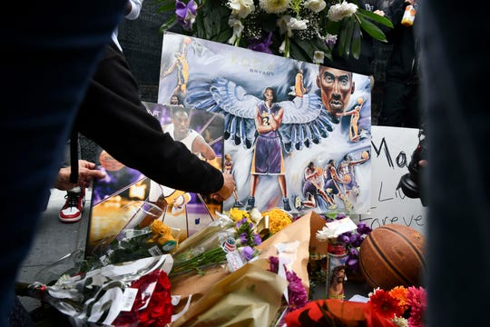 Fans mourn the loss of NBA legend Kobe Bryant outside the Staples Center in Los Angeles.