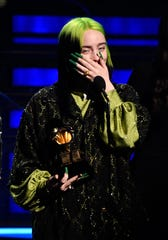 Billie Eilish accepts the award for record of the year during the Grammy Awards.