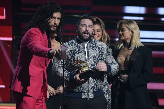 """Dan Smyers, left, and Shay Mooney accept the Grammy for best country duo/group performance for """"Speechless."""""""