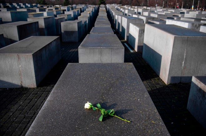 A rose lies on one of the concrete steles of the Memorial to the Murdered Jews of Europe (Holocaust memorial) in Berlin on Jan. 27, 2020, to commemorate the 75th anniversary of the liberation by Soviet troops of the Auschwitz-Birkenau concentration camp in Poland.