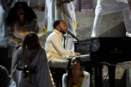 John Legend plays piano during a tribute to rapper Nipsey Hussle, who died in 2019.