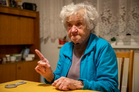 In this photo taken Friday, Jan. 24, 2020, Nazi camps survivor Marija Frlan, who will turn 100 on the Holocaust Remembrance day, talks to the Associated Press during an interview at her home in Rakek, Slovenia. Frlan, who was held at the Ravensbruck camp in northern Germany for over a year in 1944-45, will join other survivors and officials in Poland on Monday for the ceremonies marking the 75th anniversary of the liberation of the Auschwitz camp.