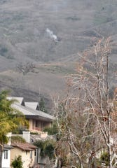 Smoke rises from the scene of a helicopter crash on a hillside in Calabasas, California, on Sunday. Nine people were killed, including former NBA superstar Kobe Bryant and one of his daughters.