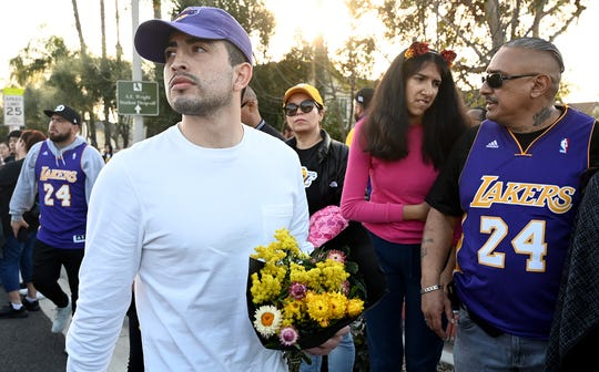 Fans gather in Calabasas near the hillside where a helicopter crash killed Lakers legend Kobe Bryant.