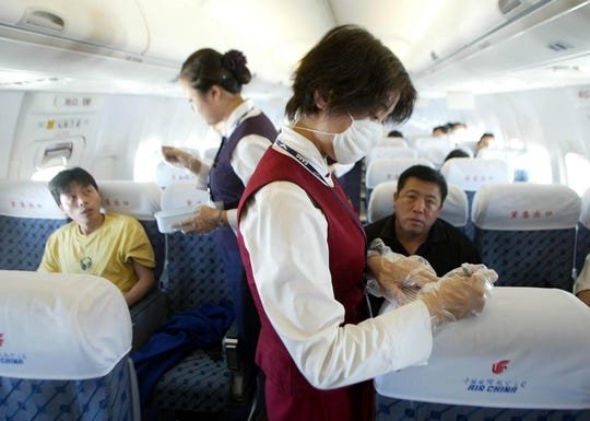 During the SARS outbreak of 2003, Air China flight attendants took passenger's temperatures before letting them deplane.