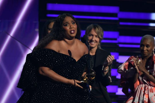Lizzo accepts the award for best pop solo performance during the 62nd annual Grammy Awards.
