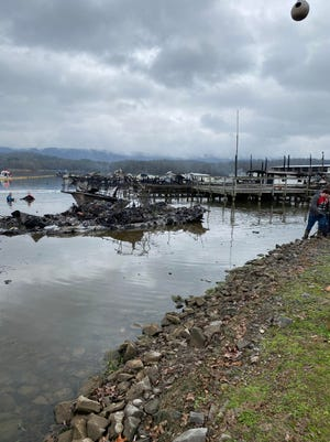 The scene Jan. 27, 2020, after a fire at a boat dock near Scottsboro, Ala., destroyed 35 watercraft and left eight people dead, according to the city's fire chief.
