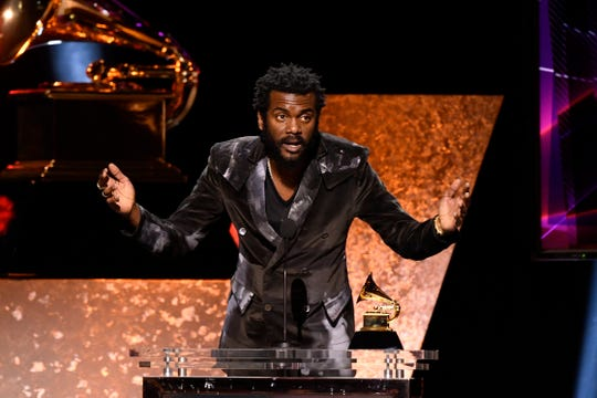 """Gary Clark Jr. accepts the award for best rock performance for """"This Land"""" during the 62nd annual GRAMMY Awards."""