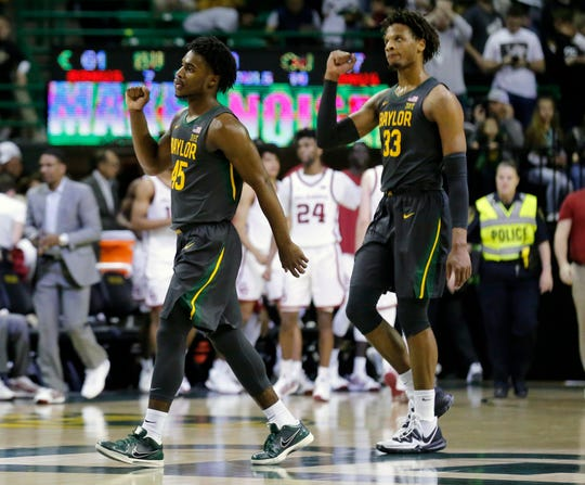 Baylor guard Davion Mitchell (45) and forward Freddie Gillespie celebrate after their 61-57 victory against Oklahoma at Ferrell Center.