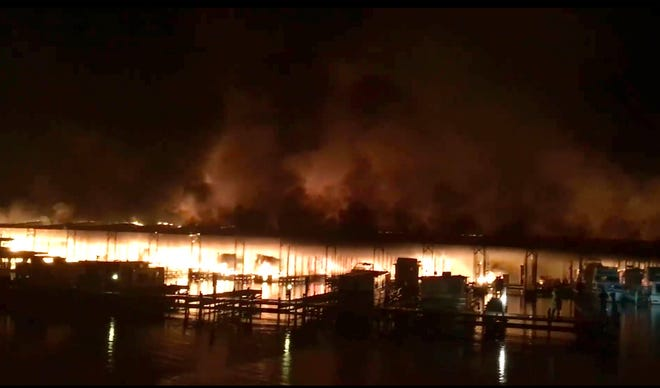 This photo provided by Mandy Durham shows a fire burning on a dock where at least 35 vessels, many of them houseboats, were destroyed by fire early Jan. 27, 2020, in Scottsboro, Ala.