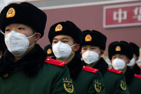 Chinese police officers wearing masks stand in front of the Tiananmen Gate on Jan. 26, 2020 in Beijing, China. The number of cases of coronavirus rose to 1,975 in mainland China on Sunday. Authorities tightened restrictions on travel and tourism this weekend after putting Wuhan, the capital of Hubei province, under quarantine on Thursday. The spread of the virus corresponds with the first days of the Spring Festival, which is one of the biggest domestic travel weeks of the year in China.