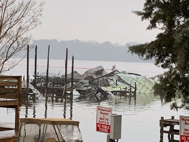 The remains of a dock where at least 35 vessels, many of them houseboats, were destroyed by fire early Monday, Jan. 27, 2020, in Scottsboro, Ala. Scottsboro Fire Chief Gene Necklaus is confirming fatalities in a massive fire at a boat dock. (Sierra Phillips/WAAY-TV via AP) ORG XMIT: ALHO101