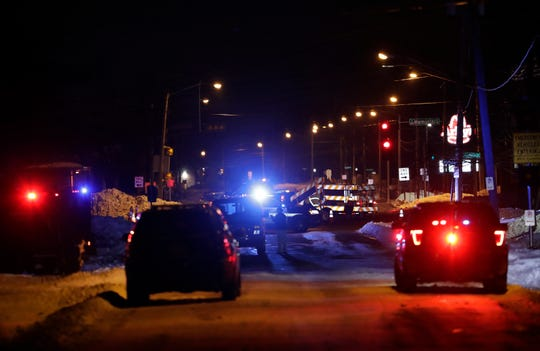 Emergency vehicles line both sides of Grove Street looking eastward towards where it meets Lynch Avenue Tuesday, Jan. 21, 2020, in Appleton, Wis. Past the barricades is South Memorial. Photo is taken from the point where Grove Street meets Gardner's Row.