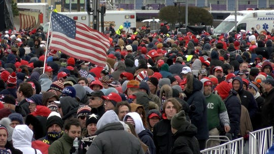 People wait outside the Wildwood Convention Center Tuesday in anticipation of President Trump speaking there later in the day.