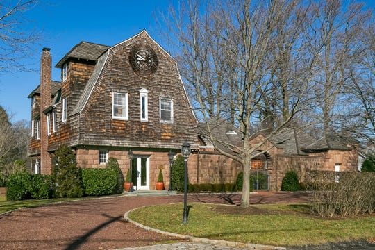 Rumson's home at 68 W.River Road adorns timeless character.