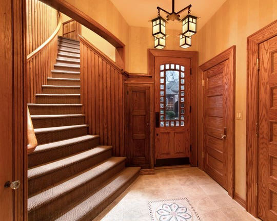 In the foyer features high ceilings, beautifully restored custom millwork.