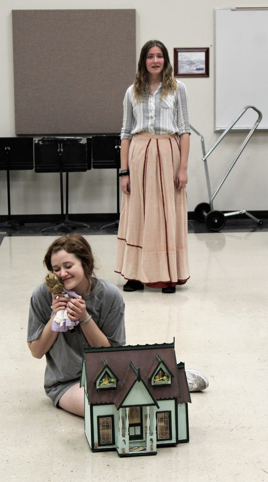"""Maddie Lowry, a Wylie High alum, is one of two Marys in Hardin-Simmons University's production of """"The Secret Garden,"""" which opens Wednesday. While Mary cradles a doll, the deceased Lily (Emily Hatch) sings to open the musical. HSU was in rehearsal off stage this week."""