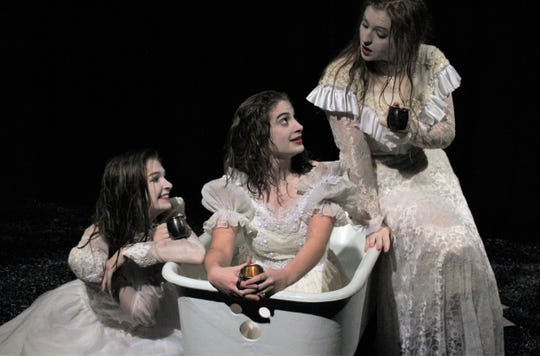 "From left, Cassidy Davis, Bethany Soder and Bailee Barrett toast the good times in their lives when George Joseph Smith wooed them into marriage, before killing them,  in this rehearsal scene from Hardin-Simmons University's student-directed ""The Drowning Girls."" Jan 27 2020"