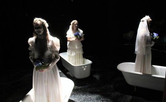 "Three deceased women arise from their bathtubs as brides - from left, Cassidy Davis, Bethany Soder and Bailee Barrett - to tell how they came to be drowned by George Joseph Smith in this rehearsal scene from Hardin-Simmons University's student-directed ""The Drowning Girls,"" which is on stage twice this weekend. Jan. 27 2020"