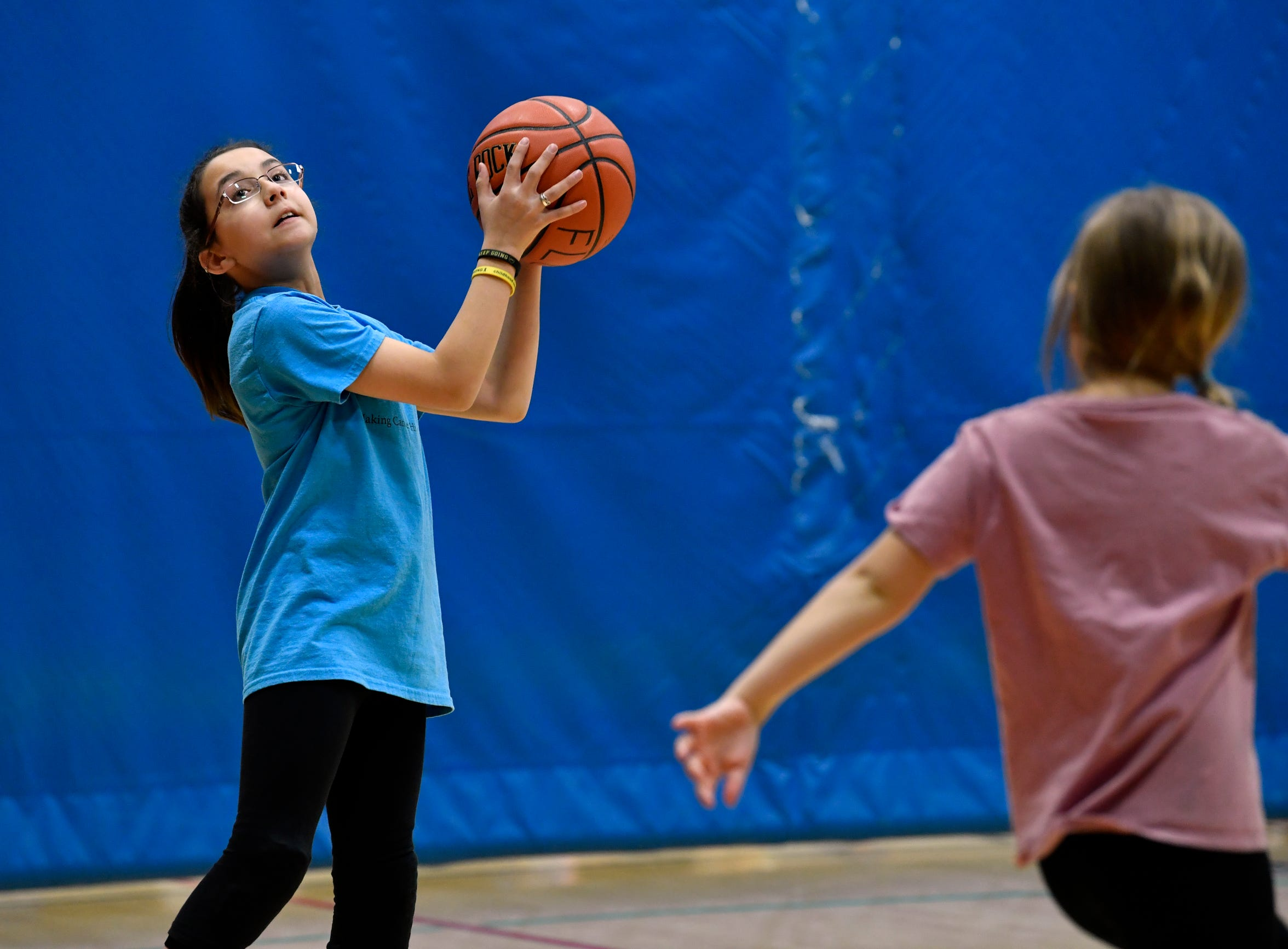 Ciara Husing, 10, plays basketball during a league practice at First Baptist Church Dec. 5. She was excited to be playing again after the fight for her life. Ciara was diagnosed with synovial sarcoma, a tissue cancer found in the body's extremities, in August 2018.