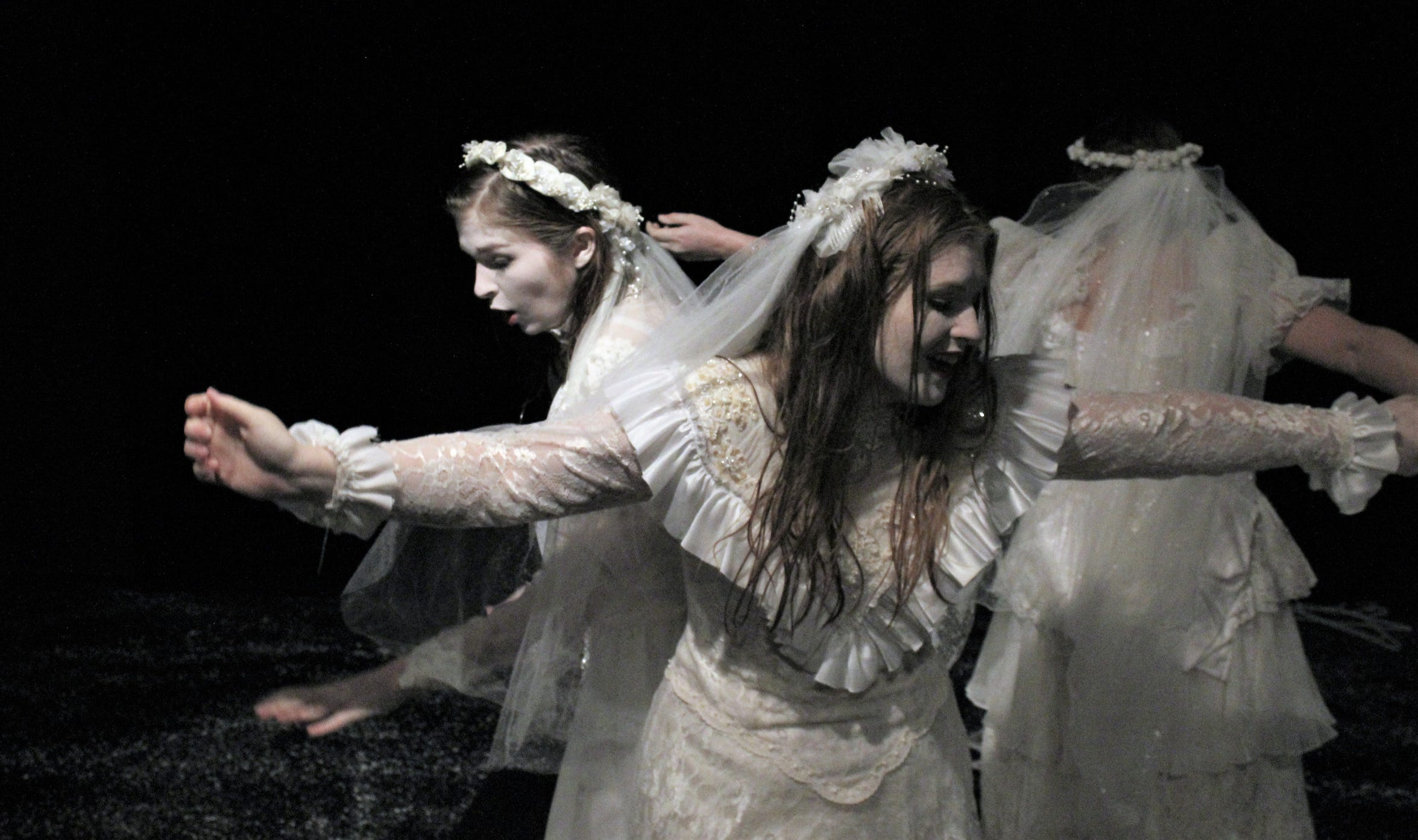 """The three women killed by serial murderer George Joseph Smith, when each was married him, dance after coming back to life in this rehearsal scene from Hardin-Simmons University's student-directed """"The Drowning Girls."""""""