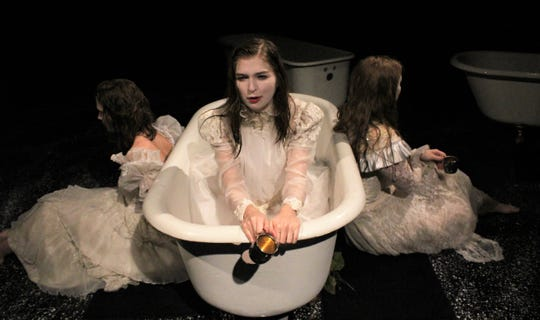 """Cassidy Davis, center, holds her tea cup while reflecting on her life with two other women once married to George Joseph Smith, and then killed by him, in this rehearsal scene from Hardin-Simmons University's student-directed """"The Drowning Girls."""""""