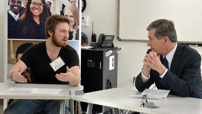 Gov. Roy Cooper talks with student Dylan Hudson at the Henderson County Innovative High School on Jan. 27 to kickoff Jumpstart Jobs Week, a community-wide event to connect local employers with high school students in the Jobs for North Carolina's Graduates (JNCG) program.