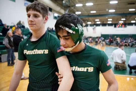 "Pennfield varsity wrestler Nasko Cleland, who is blind, warms up with his teammate Caleb Smith on Wednesday, Jan 22, 2020 at Pennfield High School in Battle Creek, Mich. ""I feel like I can be good at it because I can use feel and I don't need my vision,"" Clelend said."