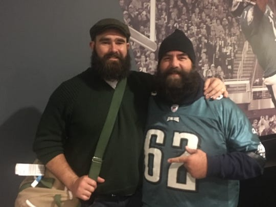 Philadelphia Eagles center Jason Kelce, left, poses with cousin Tom Kelce, the varsity baseball coach at Holy Trinity Episcopal Academy. Jason's brother, Travis, will be playing in Super Bowl LIV for the Kansas City Chiefs.