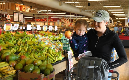 Christina Hanstein and her 2-year-old daughter Preslee shopping at the  West Melbourne Lucky's Market at 3170 W. New Haven Avenue, at the intersection of Wickham Road.