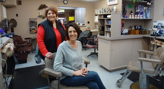 Brandy Robertson, left, is still working at the East Rensselaer Street beauty salon she owned for almost 45 years. New owner Kaye Pifer will have a ribbon-cutting on Friday at Kaye & Co. Salon.