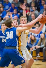 Colonel Crawford's Reis Walker keeps the ball away from Wynford's James Schiefer.