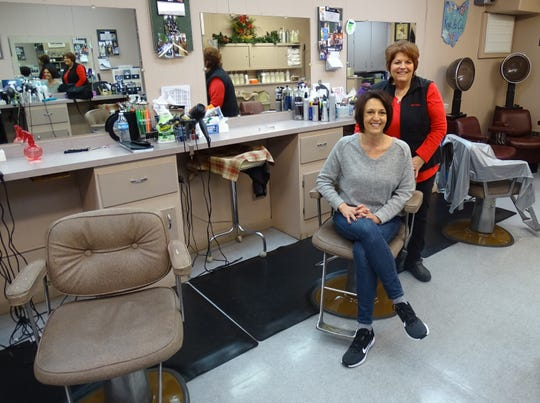 New owner Kaye Pifer, seated, will have a ribbon-cutting on Friday at Kaye & Co. Salon. Brandy Robertson, right, is still working at the East Rensselaer Street beauty salon she owned for almost 45 years.