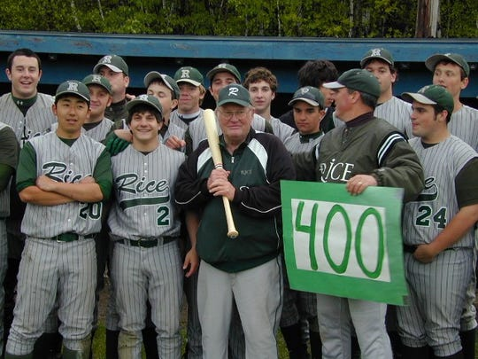 Players surround Mike Pearo after the Rice coach captured the 400th win of his career in 2007.