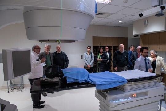 Visitors tour a radiation therapy treatment room inside Inspira Health's new cancer treatment center in Mullica Hill. The center is set to open sometime February, pending state licensing approval.