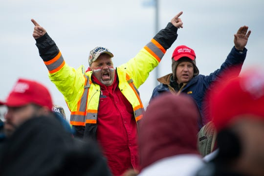 Trump supporters rally while waiting in line outside of the convention center Tuesday, Jan. 28, 2020 in Wildwood, N.J.