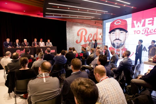 From left, Nick Krall, Reds General Manager, David Bell, Reds manager, Bob Castellini, Reds CEO, Dick Williams, Reds Player Operations president, Nick Castellanos, Reds outfielder, Scott Boras, Castellanos agent, sit at Castellano's first press conference as a Reds outfielder on Tuesday, Jan. 28, 2020 at Reds Hall of Fame and Museum in downtown Cincinnati. Casellanos has agreed to terms on a 4-year, $64-million contract through the 2023 season.