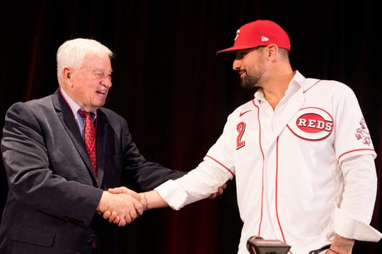 Reds CEO Bob Castellini speaks with Nick Castellanos after a press conference announcing Castellanos as a Reds player Tuesday, Jan. 28, 2020 at Reds Hall of Fame and Museum in downtown Cincinnati. Casellanos has agreed to terms on a 4-year, $64-million contract through the 2023