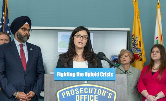 Union County Prosecutor Lyndsay Ruotolo talks at the news conference Tuesday. From left to right: New Jersey Attorney General Gurbir Grewal,  Union County Prosecutor Lyndsay Ruotolo and Prevention Links Chief Executive Officer Morgan Thompson (far right) .