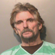 Mark W. Freemyer, 59, shown in a Polk County Jail mugshot.