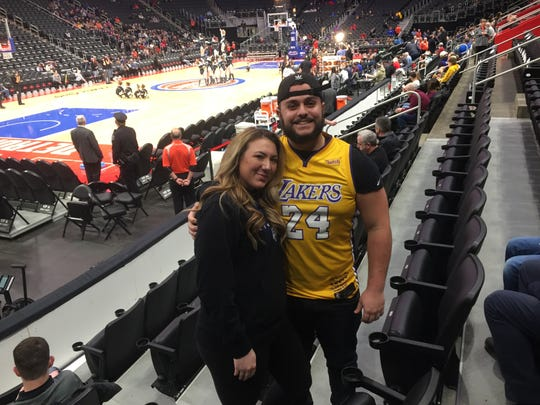 Jake Simon, right, of Clinton Township, wears his Kobe Bryant jersey next to his girlfriend Antoinette Campo on Monday at LCA.