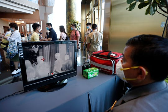 A Thai worker monitors thermal scanner screen showing the temperature of shoppers at a shopping mall in Bangkok, Thailand, 27 January 2020. Thai health officials are stepping up monitoring and inspection for the new SARS-like coronavirus after the Public Health Ministry confirmed eight cases in the country. The virus has so far killed at least 80 people and infected around 2,700 others, mostly in China.