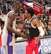 Pistons' Langston Galloway, wearing a jersey honoring Lakers great Kobe Bryant, with Thon Maker before the game Monday.