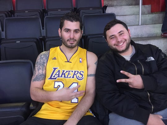 Anthony Yousif, left, of Detroit, wears his Kobe Bryant jersey next to his cousin Marcel Mansor on Monday at LCA.