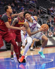 Detroit Pistons forward Christian Wood (35) drives against Cleveland Cavaliers forward John Henson (31) during third period action Monday, January 27, 2020 at Little Caesars Arena in Detroit, Mich.