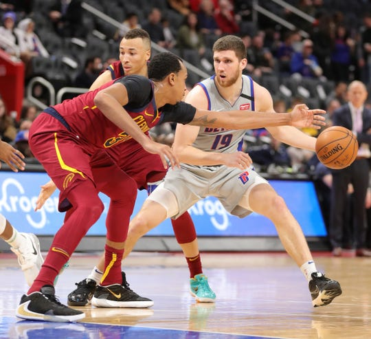Detroit Pistons guard Sviatoslav Mykhailiuk (19) drives against Cleveland Cavaliers forward John Henson (31) during fourth period action Monday, January 27, 2020 at Little Caesars Arena in Detroit, Mich.